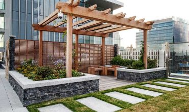 Street furniture on rooftop garden by Acer Landscapes Ltd